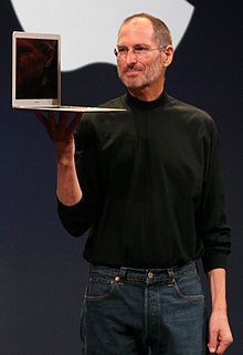 jobs holding apple macbook